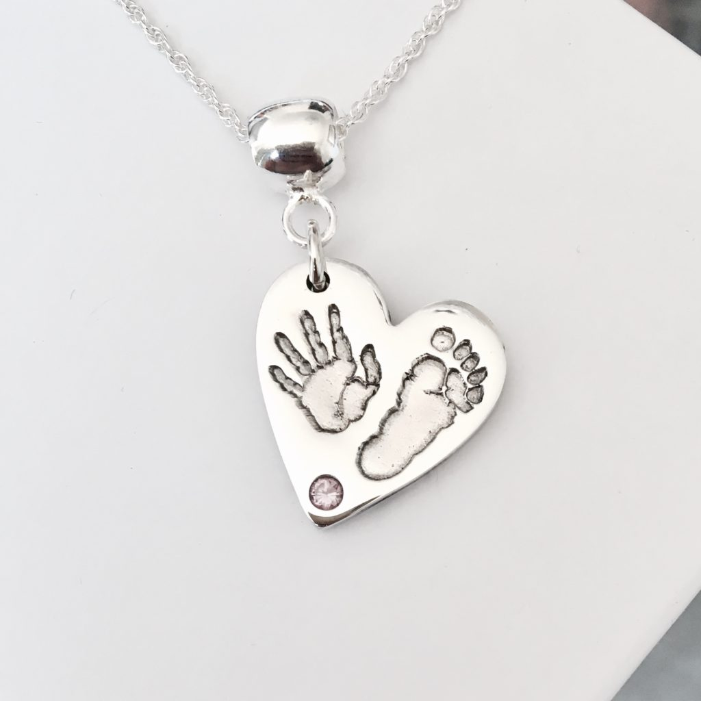 Handprint heart pendant with pink stone