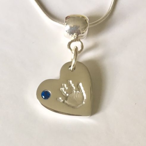 handprint necklace with blue stone