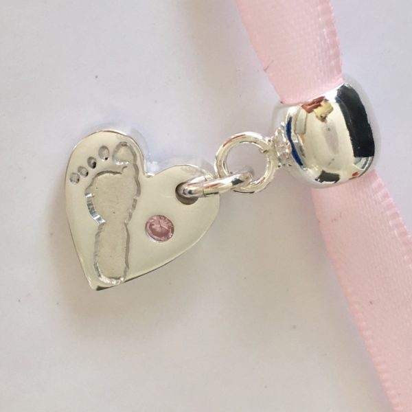Footprint Charm with a Pink Stone