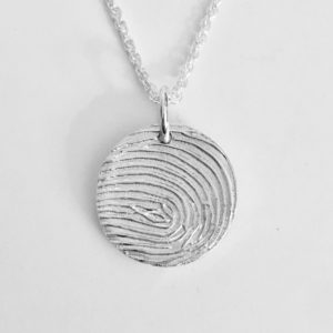 circular fingerprint pendant