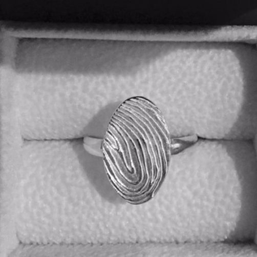 oval fingerprint ring