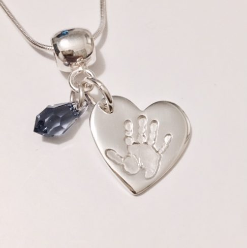 Handprint Pendant with purple stone