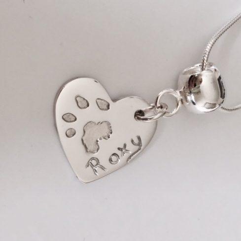 Paw print silver heart pendant