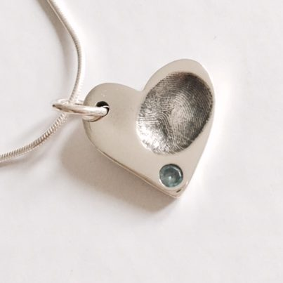 fingerprint jewellery with blue stone