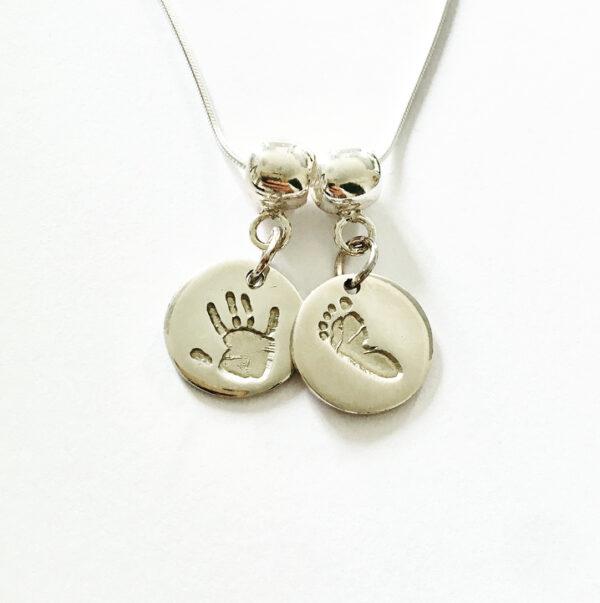 Circle hand and footprint pendant