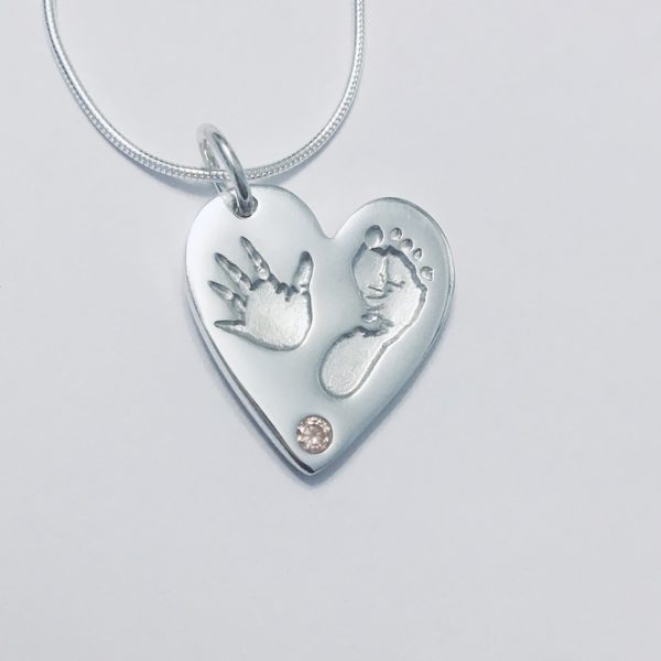 heart handprint silver pendant with pink stone