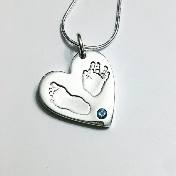 hand and footprint pendant with blue stone