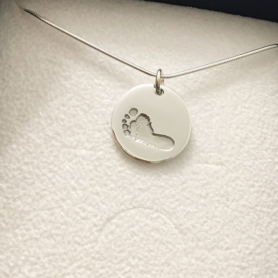 silver footprint circle necklace