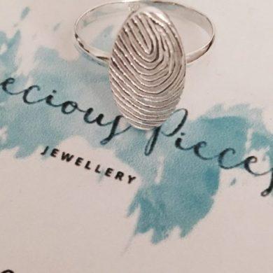 Oval fingerprint ring